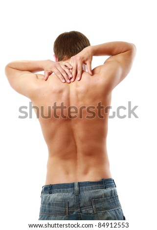young man with pain on upper back - stock photo