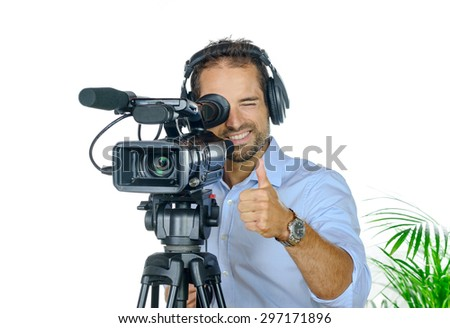 Young man with professional movie camera on white background