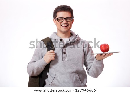 Young man with red apple