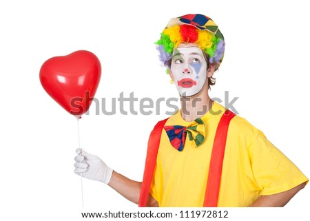 Young man with red heart shaped balloon - isolated