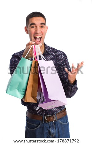 young man with shopping bags - stock photo