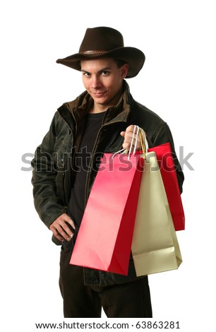 Young man with shopping bags wearing winter clothes isolated on white - stock photo