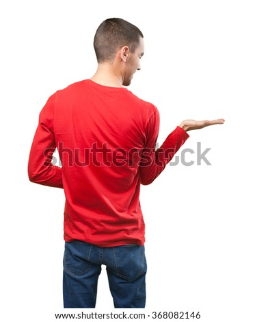 Young man with show gesture - stock photo
