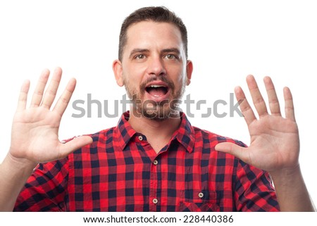 Young man with squares shirt over white background.