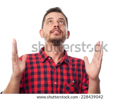 Young man with squares shirt over white background. Looking bliss