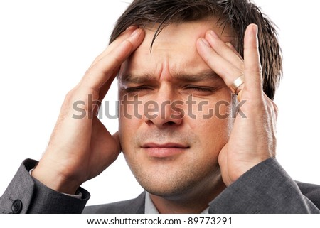 Young man with strong migraine, isolated on white background - stock photo