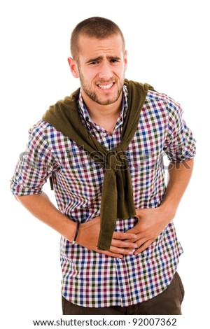 Young man with strong stomach pain isolated on white background - stock photo
