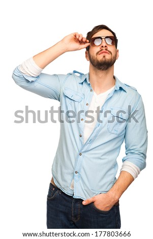 young man with sunglasses looking up on white background