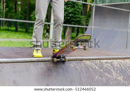 Young man with the skateboard in the park