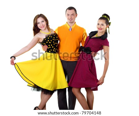 young man with two women in bright colour wear swing style - stock photo