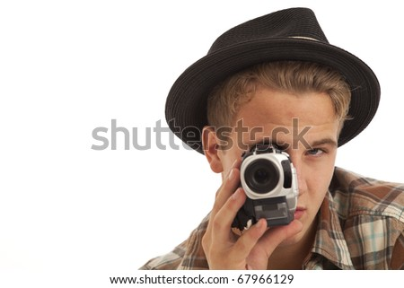 Young man with video camera