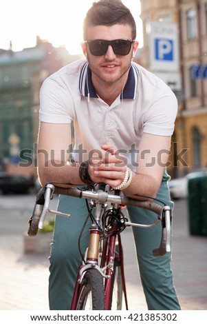 Young man with vintage race bike