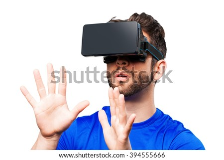young man with virtual reality glasses - stock photo