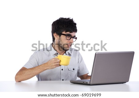 young man working and drinking coffee (isolated on white) - stock photo