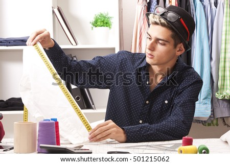 young man working in his textile business