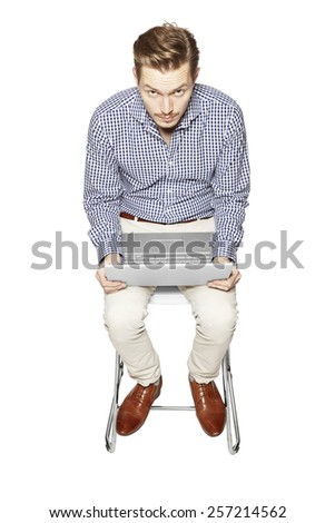 Young man working on a computer - stock photo