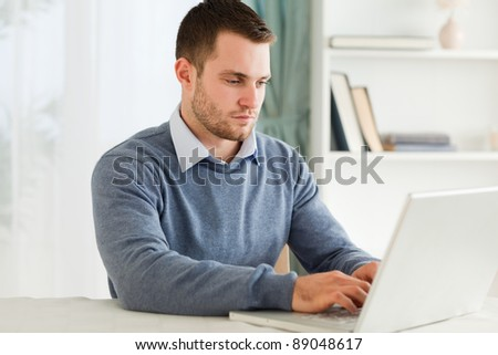 Young man working on his notebook - stock photo