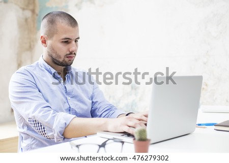 Young man working on laptop in he office