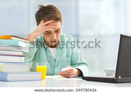 Young man working on laptop in office. - stock photo