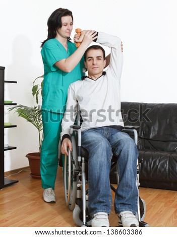 Young Man Working With a Physical Therapist - stock photo