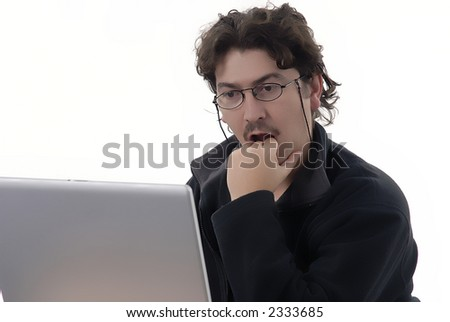 young man working with computer in a white background