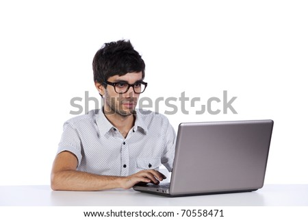 young man working with his laptop computer - stock photo