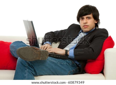 young man working with laptop in a couch
