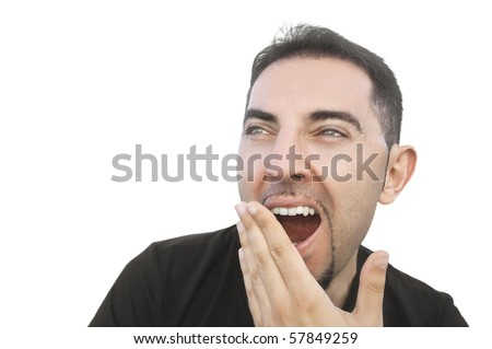 Young man yawning. - stock photo