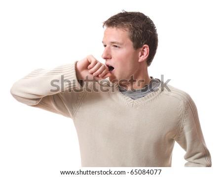 young man yawning isolated on white background - stock photo