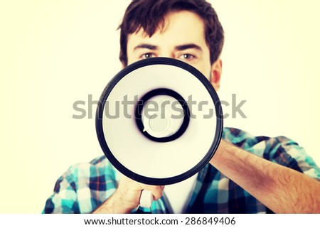 Young man yelling into megaphone. - stock photo