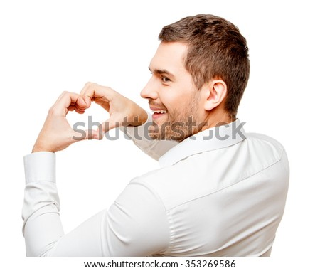Young man Young man showing heart by hands isolated on white - stock photo