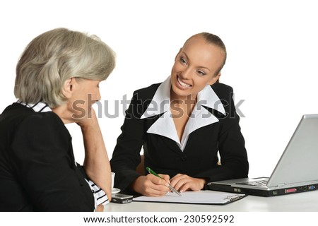 Young manager and elderly customer have a talk in office - stock photo