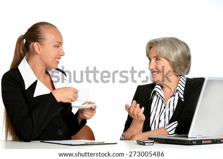Young manager and her elderly customer have a talk in office - stock photo