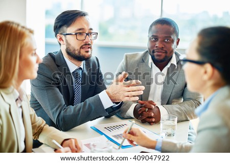 Young manager expressing his ideas at meeting - stock photo