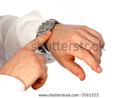 young manager looks at hours and checks accuracy on  white background, close-up - stock photo