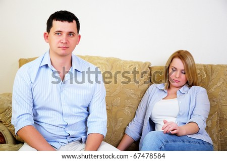 Young married couple at odds. Man and woman can not agree - stock photo