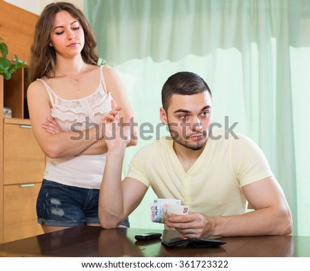Young married couple having a financial problems 