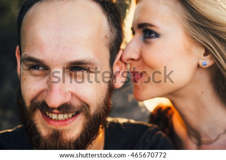 young married couple in park, a kiss, game, have rest. Sand under legs