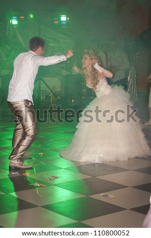 Young married couple in the wedding day - stock photo