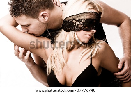 young masked couple in love, studio shot on white - stock photo