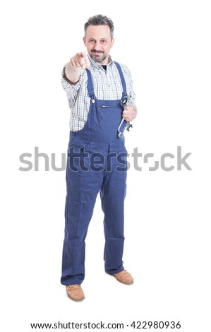 Young mechanic standing and pointing finger at you with while holding wrench isolated on white - stock photo