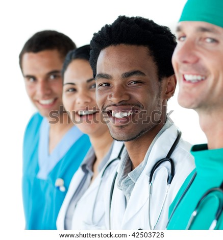 Young medical people smiling at the camera against a white background - stock photo