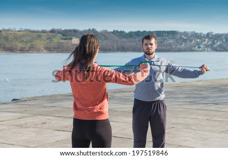 young men and a girl practicing - stock photo