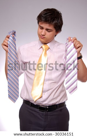 young men can't choice a tie, photo 7 - stock photo