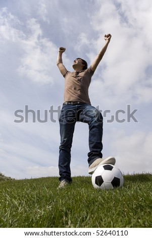 Young men celebrating a soccer goal