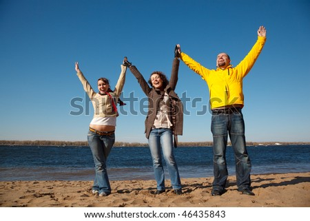 Young men on the nature have victoriously thrown up hands upwards. Productive leisure leads to success. - stock photo