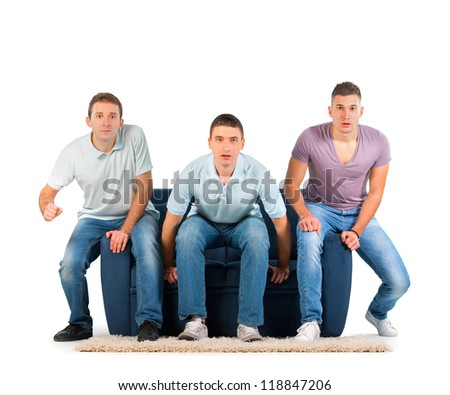 Young men sitting on a sofa. Anticipation. On white background - stock photo