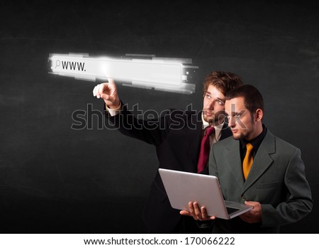 Young men touching web browser address bar with www sign
