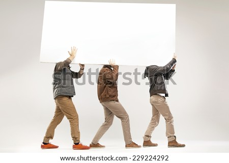 Young men with empty board - stock photo