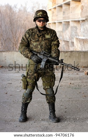 Young military man with a big rifle
